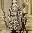 Young girl in plaid dress
