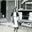 Mrs. Katie Groce in Front of the Barber Shop