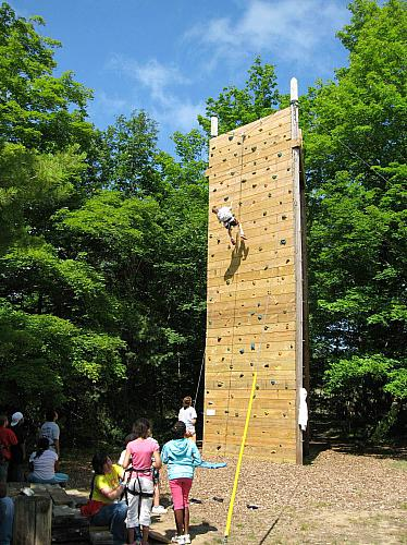 Climbing the Rock Wall at Camp Blodgett